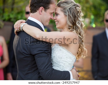 Happy newlyweds dancing on their wedding day - stock photo