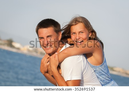Happy nice father and his daughter at beach, portrait, Italy - stock photo