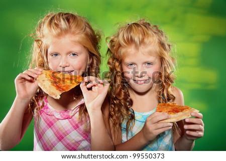 happy nice twins in studio - stock photo