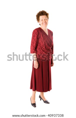 Happy old lady in red clothes standing isolated on white - stock photo