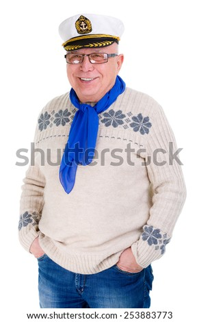 Happy old senior man with a smile and white teeth, put his hands in pocket jeans, captain cap on head, isolated on white background - stock photo