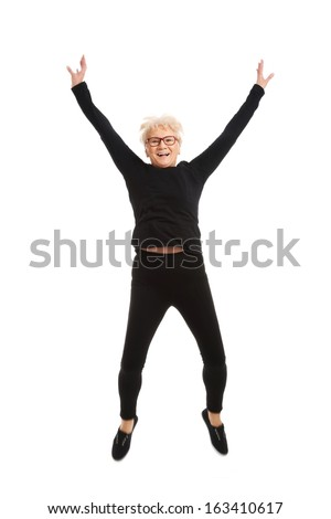 Happy old woman jumping. Isolated on white.  - stock photo