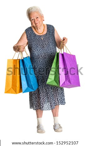 Happy old woman with shopping bags on a white background - stock photo