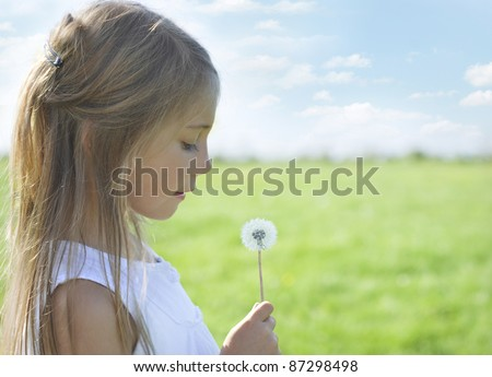 Happy on meadow - stock photo