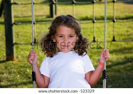 happy on the swing - stock photo