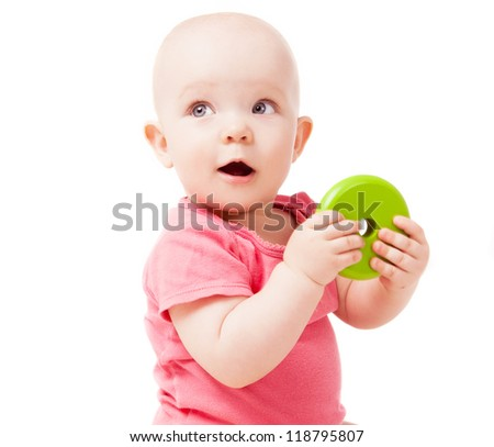 happy one year old baby playing with a toy, isolated against white background - stock photo