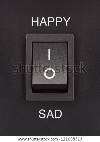 Happy or Sad black toggle switch on black surface positive negative - stock photo