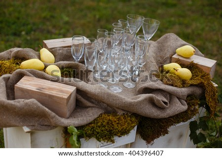 Happy outdoor Wedding Ceremony Scene for a summer mountain wedding. Wedding aisle, decorated wedding alter and flower decorations with mountains in the background. Wedding color pear - stock photo