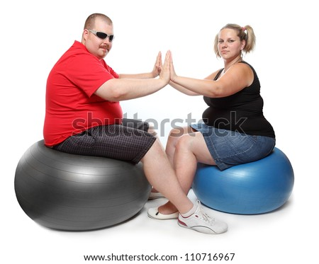 Happy overweight couple. Weight loss concept. - stock photo
