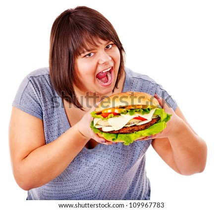 Happy overweight woman eating hamburger. Isolated. - stock photo