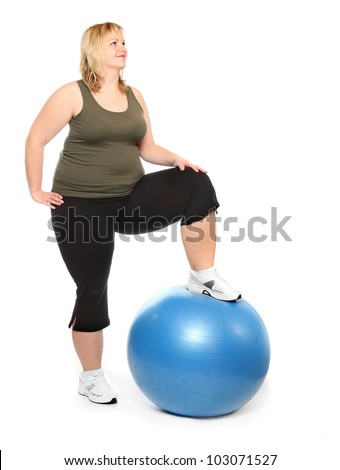 Happy overweight woman exercising with blue ball on white background. - stock photo