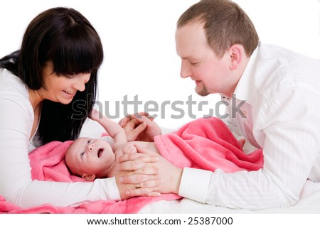 Happy parents with baby - stock photo
