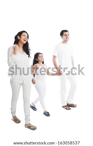 Happy parents with their daughter holding hands - stock photo