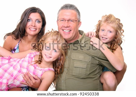 Happy parents with two daughters - stock photo