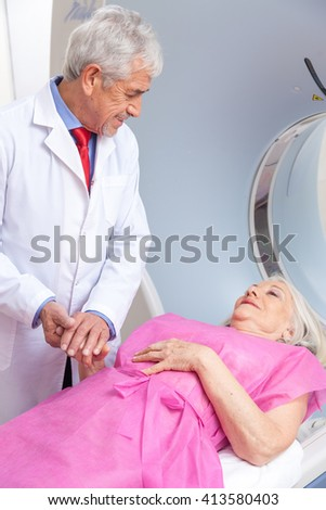 Happy patient undergoing mri scan at hospital. - stock photo