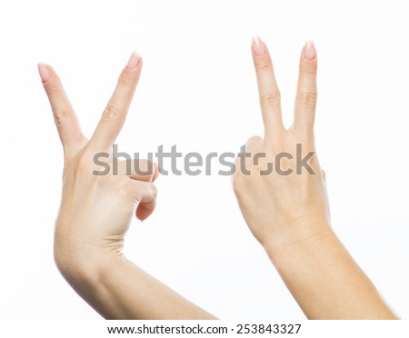 happy people concept - young woman showing victory or peace sign - stock photo