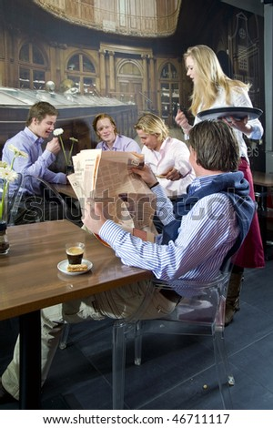 happy people having a drink in a restaurant - stock photo