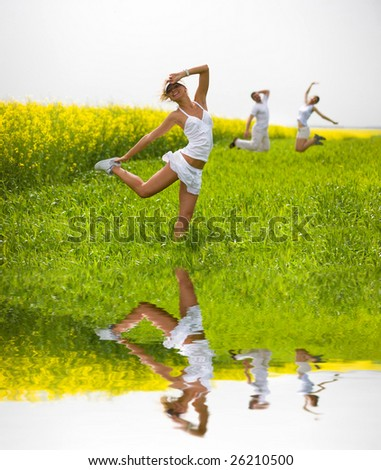 Happy people is jumping in a field - stock photo