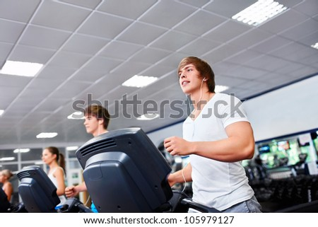 Happy people on treadmills - stock photo