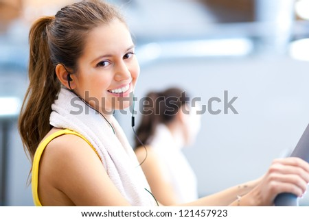 Happy people on treadmills in the gym - stock photo