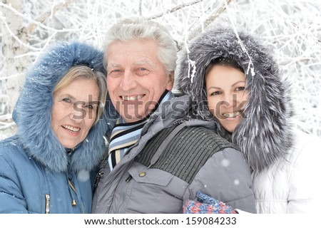 happy people went for a walk in winter - stock photo