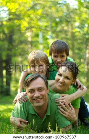Happy people went for a walk on the nature - stock photo