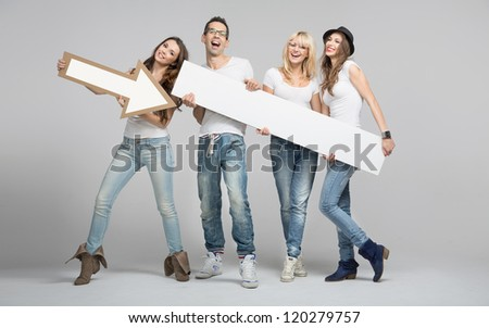 Happy people with white empty board - stock photo