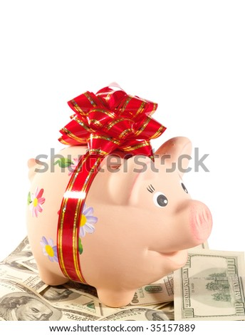 Happy Piggy Bank on the heap of dollars - stock photo