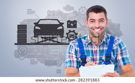 Happy plumber writing on clipboard while sitting on toolbox against grey vignette - stock photo