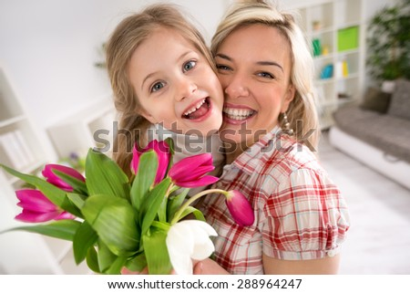 Happy portrait mother embracing her daughter, mother's Day - stock photo