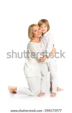 Happy portrait of the mother and son. Isolated on white - stock photo