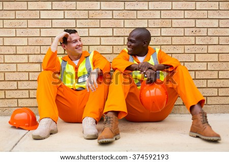 happy power company co-workers chatting during break - stock photo