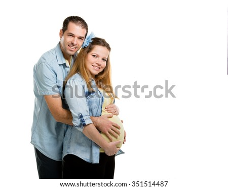 Happy pregnant couple - stock photo