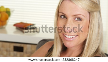 Happy pregnant woman smiling - stock photo
