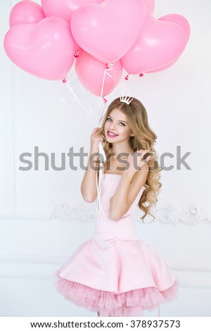 Happy pretty girl at birthday party. Happy girl with pink balloons smiling and laughing. - stock photo