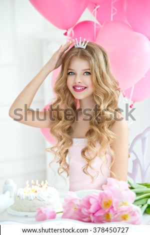 Happy pretty girl with cream cake at birthday party. Happy girl with pink balloons smiling and laughing. Barbie style - stock photo