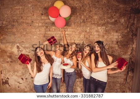 Happy pretty girls holding birthday cake, balloons and presents - stock photo