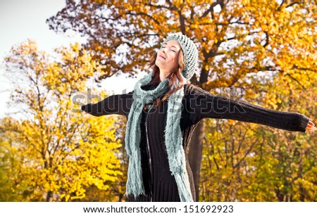 Happy pretty woman at the autumn colored park.  - stock photo