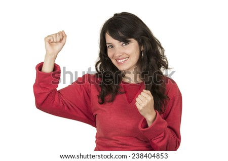 happy pretty young girl wearing red top posing with fists up gesturing yes isolated on white - stock photo