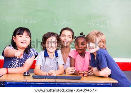 Happy primary classmates with teacher. - stock photo