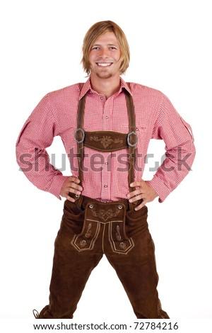 Happy proud man with oktoberfest leather trousers (lederhose) . Isolated on white background. - stock photo