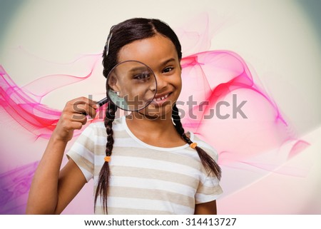 Happy pupil with magnifying glass against pink abstract design - stock photo