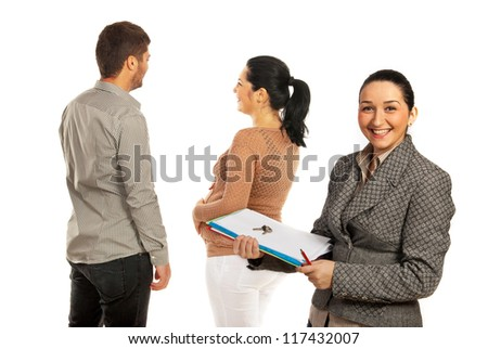 Happy real estate agent woman standing in front on happy pregnant couple isolated onw hite background - stock photo