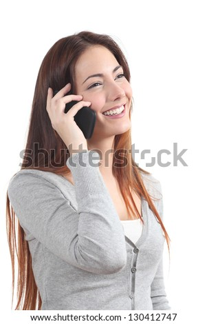 Happy redhead woman talking on mobile phone on a white isolated background - stock photo
