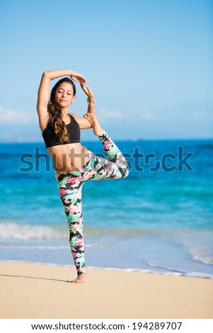 Happy relaxed young woman practicing yoga outdoors at the beach. Healthy active lifestyle. Zen Meditation. - stock photo