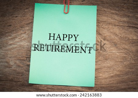 happy retirement text concept on green note  - stock photo