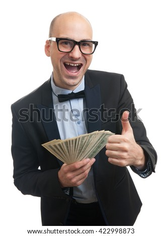Happy rich man holding a lot of money and gesturing thumb up - stock photo