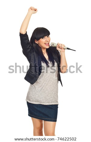 Happy rock girl sing in microphone and raising her arm isolate don white background - stock photo