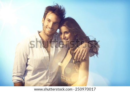 Happy romantic couple embracing at summer evening, smiling. - stock photo