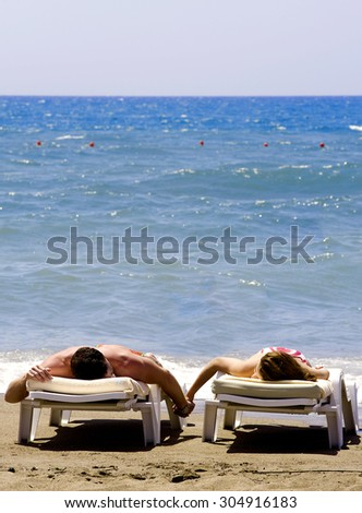 Happy Romantic Couple Enjoying at the Beach - stock photo